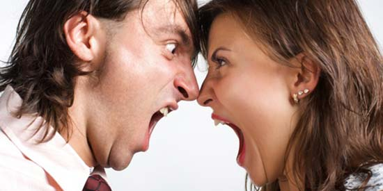 Angry couple shouting at each other need communication coaching